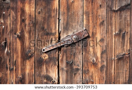 old wooden texture or background. Wooden gate with lock - stock photo