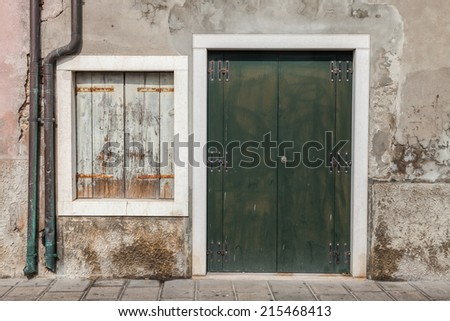 Old, wooden Tuscan door and window  - stock photo