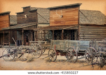 Old Wooden Wagons in a Ghost Town, Cody, Wyoming, USA - stock photo