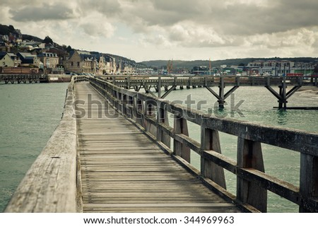 Old Wooden Walkway in the Port of Fecamp in Normandy France in Autumn - stock photo