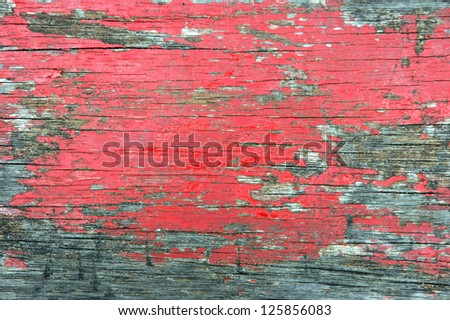 old wooden wall with the paint worn and crusty - stock photo