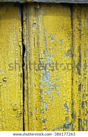 old wooden wall with yellow paint texture pattern - stock photo