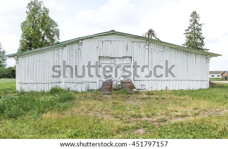 Old wooden white barn - stock photo