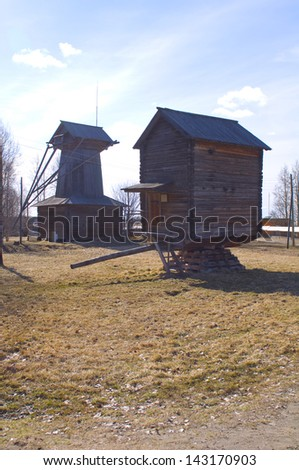 Old wooden windmill in Malye Karely (Little Karely) near Arkhangelsk, north of Russia, Europe - stock photo
