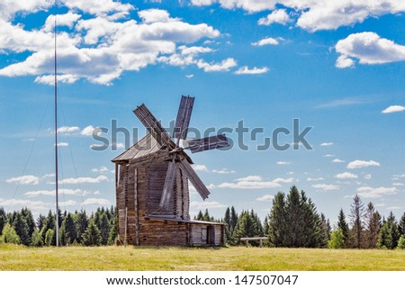 Old wooden windmill in the village Ludorvay. Udmurtia. Russia - stock photo