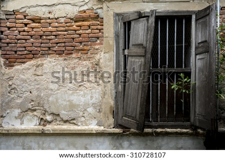 Old wooden window, detail of a building in ruins and abandoned - stock photo