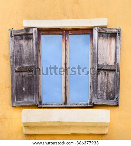 Old wooden window on yellow wall,korat,khaoyai,thailand - stock photo
