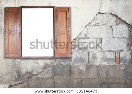 Old wooden windows frame on cement wall - stock photo