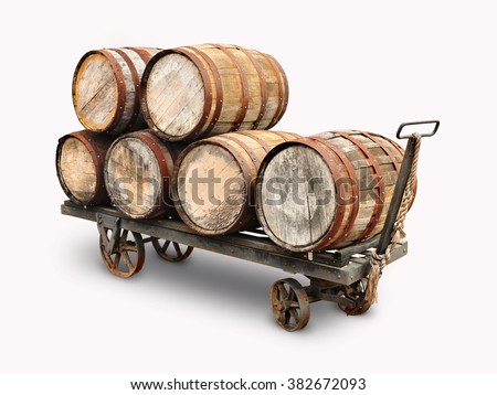 Old wooden wine barrels piled on a cart isolated in white background. - stock photo