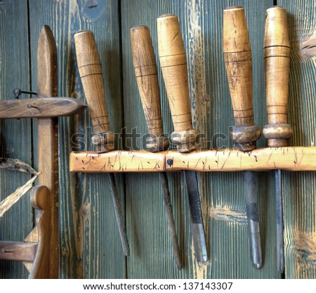 old woodworking tools on wall - stock photo