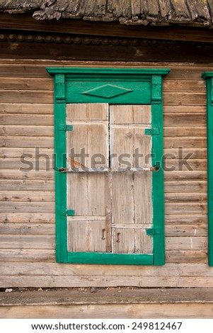 Old woody window. Old wooden window in a obsolete wall. Astrakhan, Russia. - stock photo