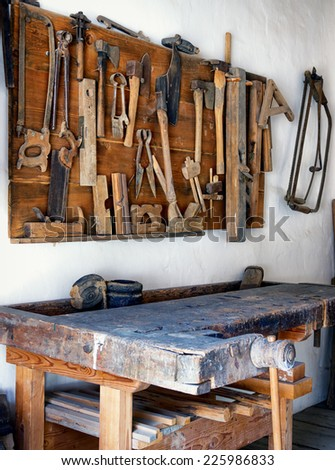 old workbench at a repair shop - stock photo