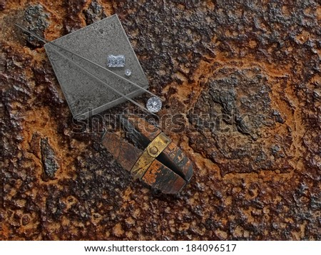 old working rusty plate with diamonds, anvil and jewelery vise - stock photo