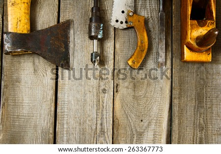 Old working tools. Many working tools on a wooden background. - stock photo
