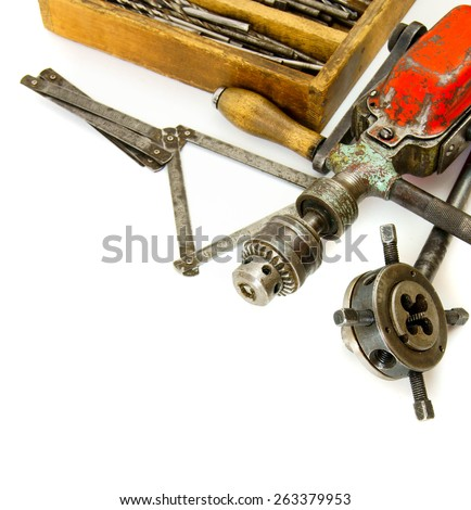 Old working tools. Vintage working tools ( drill and more) on white background. - stock photo