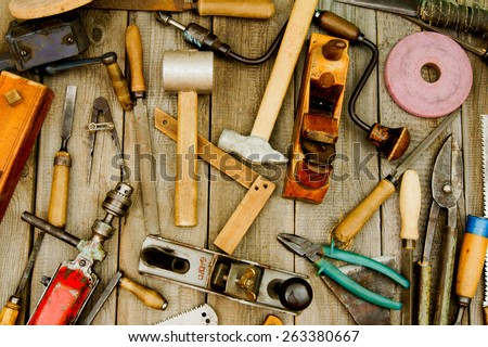Old working tools. Vintage working tools on wooden background. - stock photo