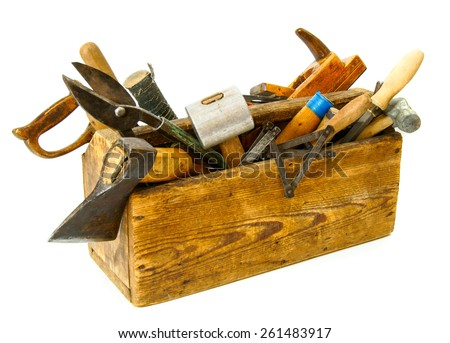 Old working tools. Working tools (pliers, chisel, plane and others) in an old box on white background. - stock photo