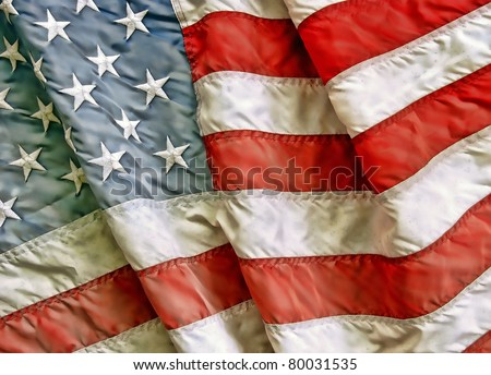 Old worn and dirty American flag - stock photo