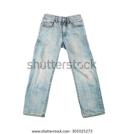 Old worn blue jeans for a boy, teenager  isolated on white background - stock photo