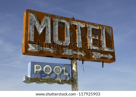 Old, worn out vintage motel sign on route 66 in Arizona - stock photo