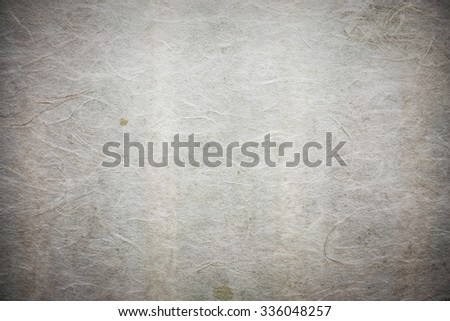 old worn paper with vintage style tone and vignette effect - stock photo