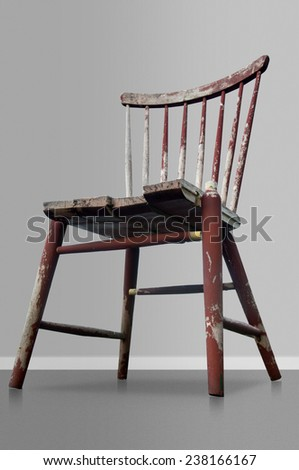 Old worn red wooden chair on gray background - stock photo