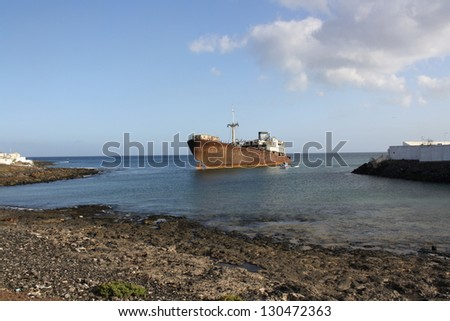 Old Wreck in the Port of Arrecife, Atlantic Sea (Lanzarote Island Spain) - stock photo