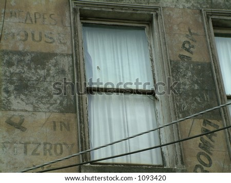 old writing over walls around window - stock photo
