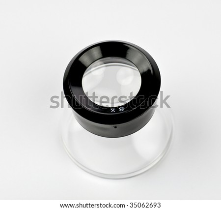 Old 8X photographic loupe - isolated on white - stock photo