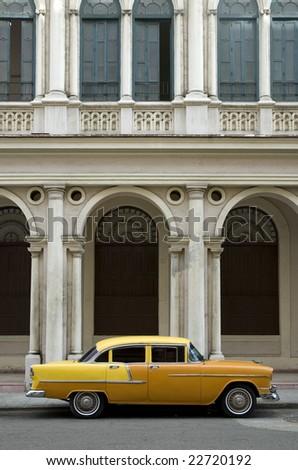 old yellow american car in old havana. cuba - stock photo