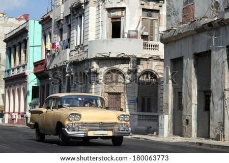 Old yellow car running in a street of Havana, Cuba - stock photo