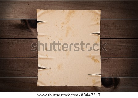 Old yellow paper on wooden wall, clipping path. - stock photo