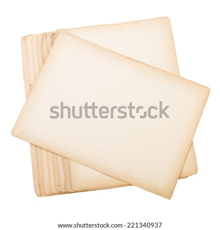 old yellow sheets of heavy paper with jagged edges  isolated on white background - stock photo