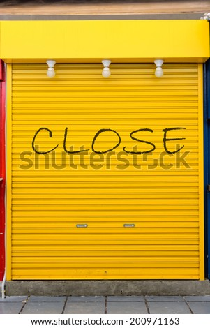 old yellow steel door - stock photo