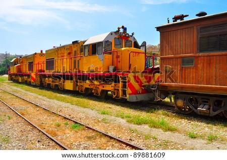 Old yellow train in Jordan - stock photo