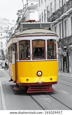 Old yellow tram in Lisbon, Portugal - stock photo