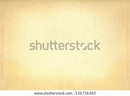 Old yellowed paper background without an inscription - stock photo