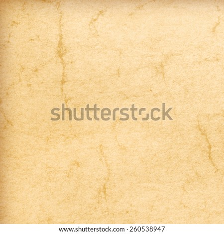 Old yellowed paper, vintage background - stock photo
