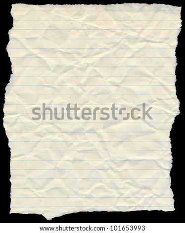 Old yellowing crumpled lined paper torn edges isolated on black. - stock photo