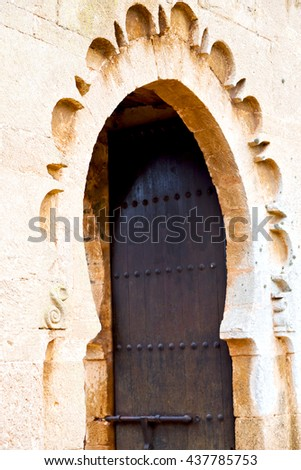 olddoor in morocco  africa ancien and wall ornate brown green - stock photo