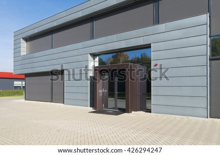 OLDENZAAL, NETHERLANDS - OCTOBER 31, 2015: Modern office building exterior on a small business park - stock photo