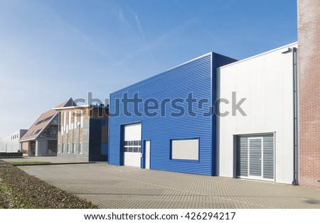 OLDENZAAL, NETHERLANDS - OCTOBER 31, 2015: Outstanding blue warehouse on a small business park in the netherlands - stock photo