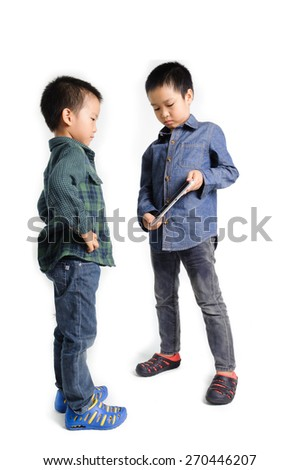 Older boy show cracked tablet device from fall to younger boy on white background - stock photo
