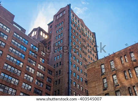 Older brownstone apartment building on the East Side of Manhattan. - stock photo