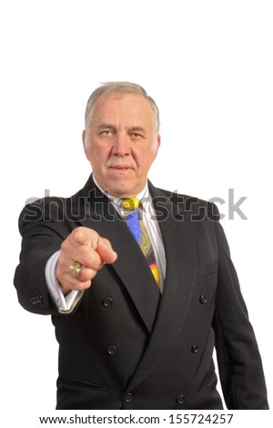 older businessman in a suit and tie pointing towards the viewer over a white background  - stock photo