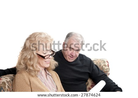 Older couple going over accounts for retirement, isolated on white - stock photo
