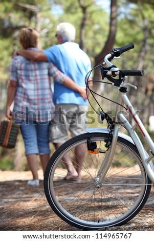 Older couple having a picnic - stock photo