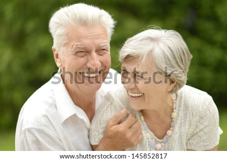 older couple in love walking in the park in spring - stock photo