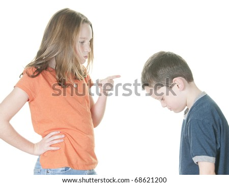 Older girl scolding younger boy - stock photo