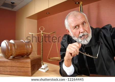 Older judge thinking and making up his mind at trial - stock photo